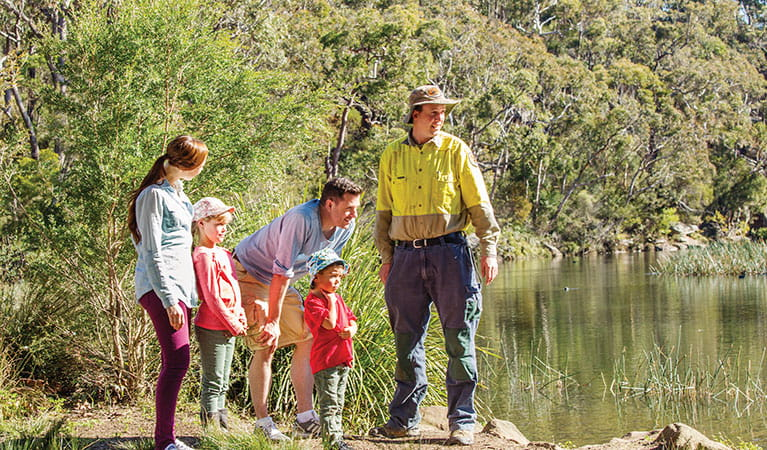 An NPWS ranger and family on a tour at Hacking River, Audley in Royal National Park. Photo: Simone Cottrell/DPIE