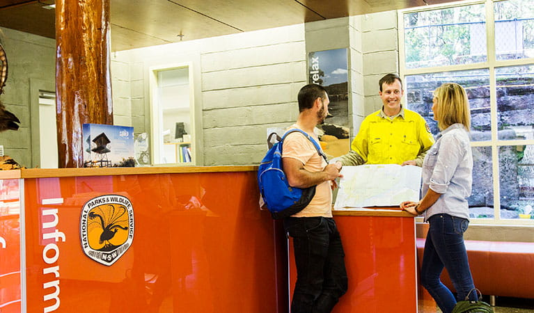 A ranger and park visitors at Royal National Park Visitor Centre, Royal National Park. Photo: Simone Cottrell/DPIE