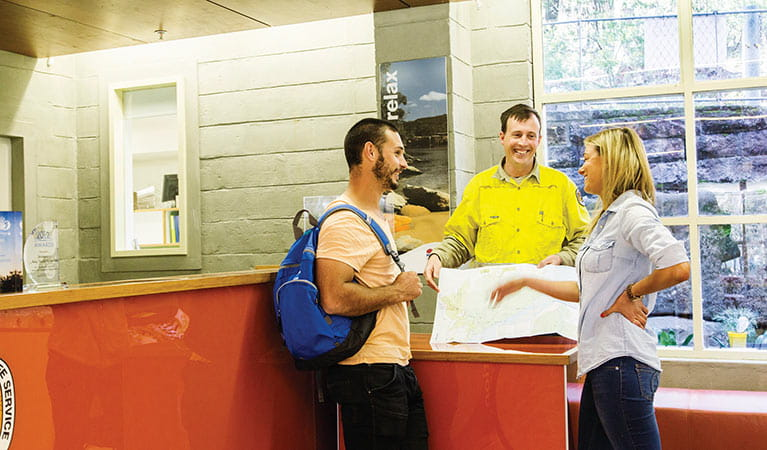 NPWS staff helping visitors at Royal National Park visitor centre. Photo: Simone Cottrell/DPIE