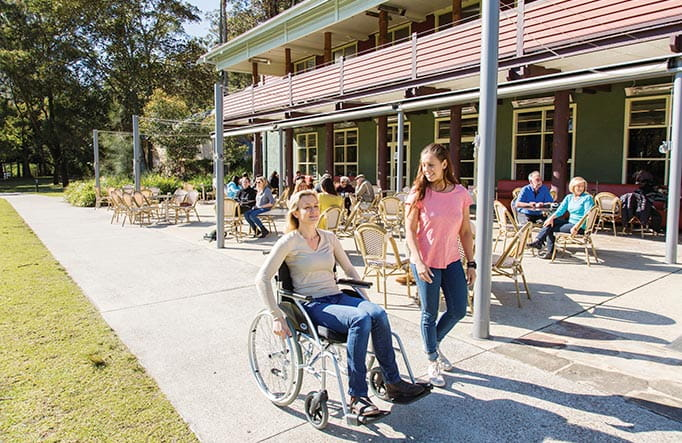 Person using a wheelchair at Audley Dance Hall Cafe. Photo: Simone Cottrell/DPIE