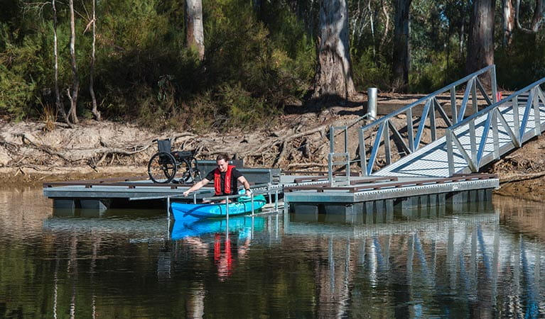 Kayaker launching off the wheelchair-accessible kayak ramp in Murray Valley Regional Park. Photo: Rhys Leslie/OEH