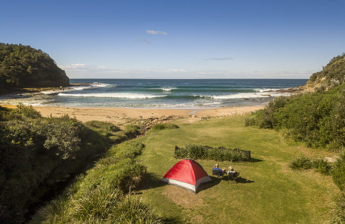 Aerial view of a tent at Little Beach campground in Bouddi National Park. Photo: John Spencer/DPIE