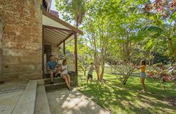 A family outside Gardeners Cottage in Sydney Harbour National Park. Photo credit: John Spencer © DPIE