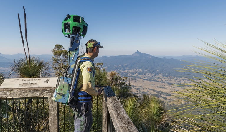 NSW National Parks Ranger with Google Street View trekker at Bar Mountain Lookout, Border Ranges National Park. Photo: John Spencer