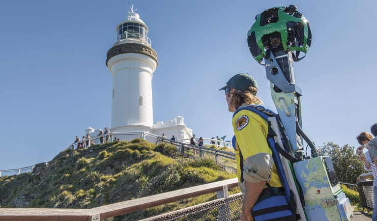 NSW National Parks ranger exploring Cape Byron Lighthouse with the Google Street View trekker. Photo John Spencer