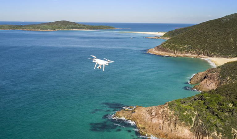 Photo of a drone flying above a national park. Photo: John Spencer/DPIE