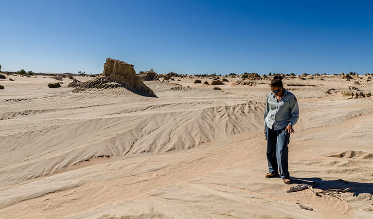 Ranger in front of the Walls of China, Mungo National Park. Photo: John Spencer