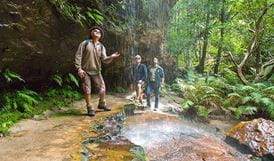 People enjoying waterfall at Grand Canyon Track, Blue Mountains National Park. Photo: Paul Cardow