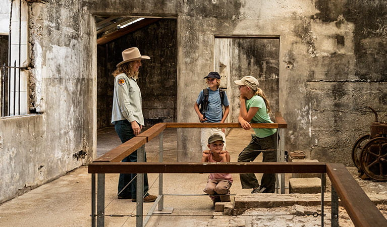 Image of kids talking to a ranger while exploring Trial Bay Gaol.