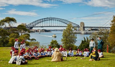 Convict Kids Goat Island school excursion set against a backdrop of the Sydney Harbour Bridge. Photo: Tanja Bruckner