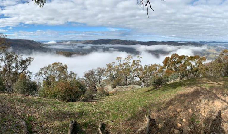 The view from a lookout of rolling hills shrouded in cloud on a 4WD tag-along camping tour with Adrenalin Offroad Centre. Photo: Ben Carceller © Adrenalin Offroad Centre
