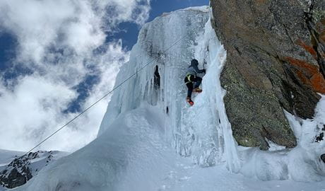 A roped climber ascends a curtain of ice in Kosciuszko National Park. Photo credit: Allie Pepper © Allie Pepper Adventures