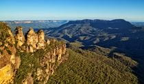 View of the Three Sisters rock formation and distant valleys and mountains in Blue Mountains National Park. Photo © Auswalk Walking Holidays