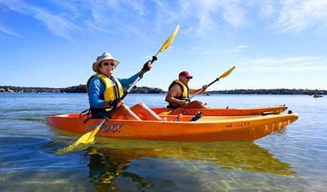2 people kayaking on a Bundeena Kayaks guided tour. Photo: Paul Robbins © Monde Photo