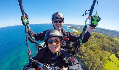 Two people on a tandem flight with Cloudbase Paragliding. Photo: Mark Rossi © Cloudbase Paragliding