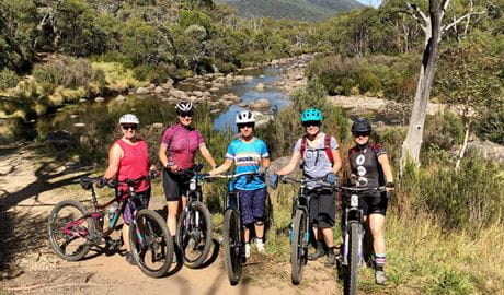Five mountain bikers in Kosciuszko National Park on a Dirt Skills and Frills women's mountain bike retreat. Photo: L. Gunther/Dirt Skills and Frills