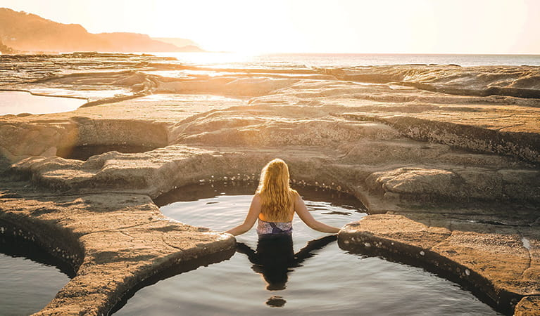 View of a young woman bathing at Figure Eight Pools in Royal National Park. Photo © Joe Bird