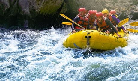 A group of people in an Exodus Adventure inflatable raft shoots a section of whitewater along the Upper Nymboida River, near Coffs Harbour. Photo © Exodus Adventures