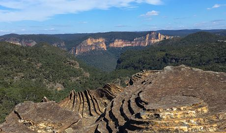 Vista of mountains and shelf-like rock formations in Blue Mountains National Park. Photo credit: J Storey © Gourmet Getaway Tours