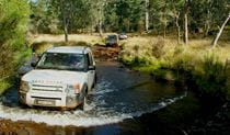 A 4WD vehicle makes a river crossing in Barrington Tops National Park. Photo credit: Vic Widman © Great Divide Tours