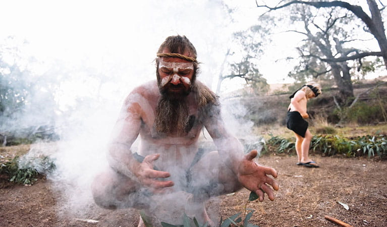 A Wiradjuri Person conducting a spiritual smoking ceremony. Photo: Isabella Moore © Milan Dhiiyaan