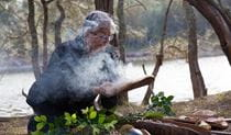 An Aboriginal guide from Minga Aboriginal Cultural Services conducting a smoking ceremony. Photo © Toby Whitelaw