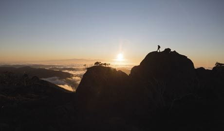 Hiker enjoying a sunset in Kosciuszko National Park. Photo: Tourism Snowy Mountains