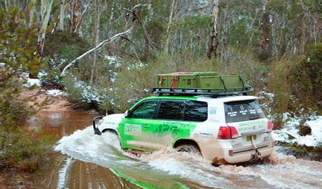 A 4WD vehicle makes a river crossing in bushland. Photo credit: Greg Simpson © Simmo's Offroad Tours