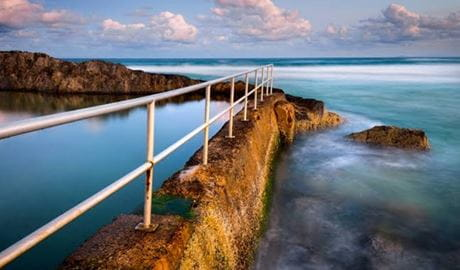 Twilight view of an ocean pool located along a rocky reef. Photo © Solitary Islands Coastal Walking Tours