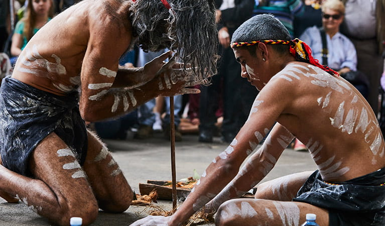 Two men share the Aboriginal cultural tradition of fire starting with visitors. Photo credit: Flash Point Labs © Tribal Warrior