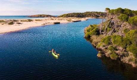 2 people canoeing along Bournda Lagoon in Bournda National Park. Photo: © Daniel Tran