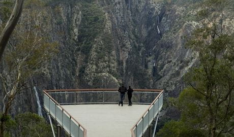 Two people admire the view from the new Wollomombi lookout, Oxley Wild Rivers National Park. Photo: Leah Pippos © DPIE