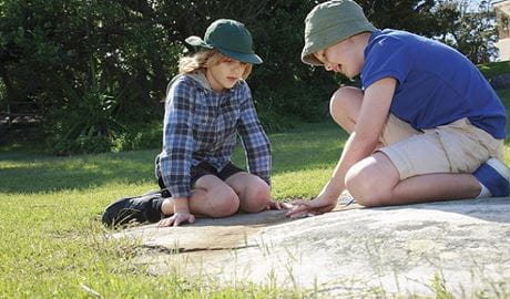 Two young boys an a nature play activity. Photo: Rosie Nicolai/OEH