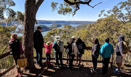 People looking at the view over Brooklyn and the Hawkesbury River, Tippers lookout, Muogamarra Nature Reserve. Photo: Theresa Willsteed/OEH