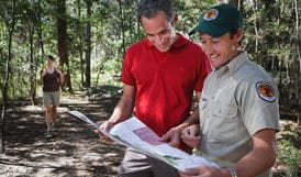 Talking to a ranger. Photo: Paul Foley/NSW Government