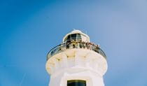 A man enjoys the ocean views from the top of Smoky Cape Lighthouse. Photo: David Finnegan/OEH