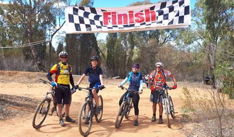 4 riders at the finish line for Tour de Gorge in Pilliga Forest. Photo: K Olsen/DPIE