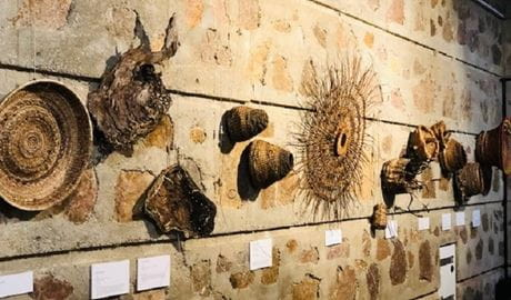 Interwoven exhibition artwork displayed on a wall. Photo: Megan DeLinaGarcia © DPIE