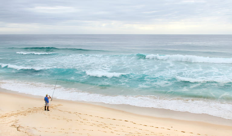 Person fishing at North Quondola Point, Ben Boyd National Park. Photo: John Yurasek