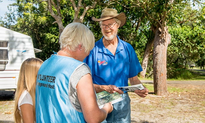 Mungo Brush campground host informs visitors, Myall Lakes National Park. Photo: John Spencer