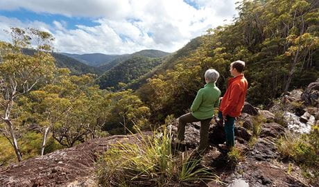 A couple of hikers looking over the valley in Gilbraltar Range National Park. Photo: Rob Cleary