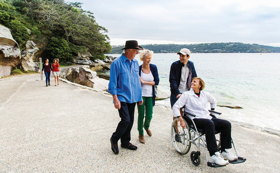 Visitors on the wheelchair accessible path at Shark Beach, Nielsen Park. Photo: Simone Cottrell/DPIE
