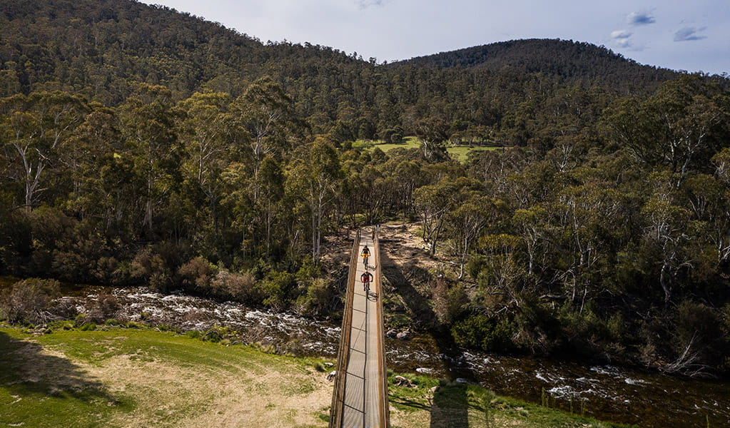 Aerial view of bridge along Thredbo Valley track crossing Thredbo River to Gaden Trout Hatchery, Kosciuszko National Park. Photo: Robert Mulally/DPIE