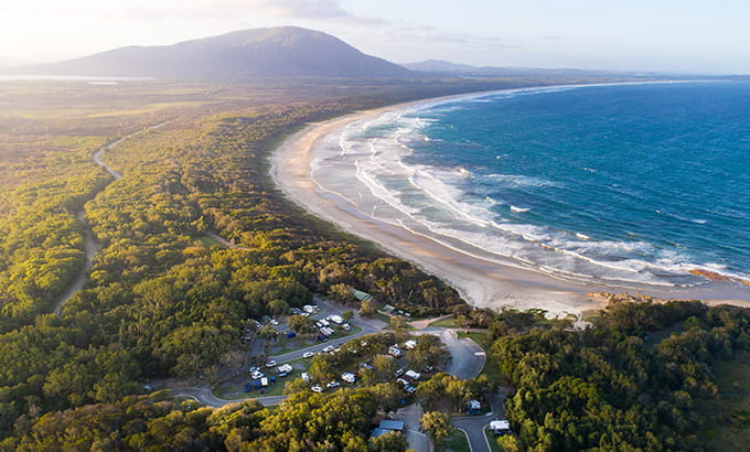 Aerial view of coastal Diamond Head campground in Crowdy Bay National Park. Photo: Robert Mulally/DPIE