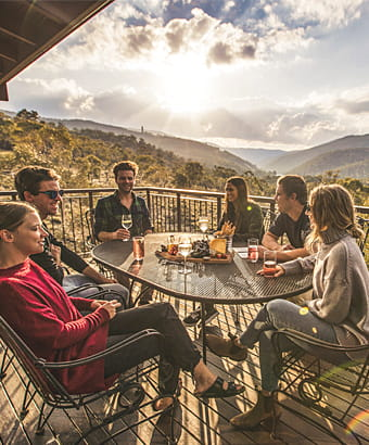 Group of friends on the balcony of Creel Lodge at sunset. Photo: Boen Ferguson/OEH