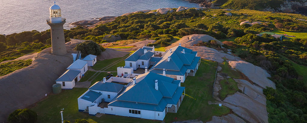Aerial view of Montague Island lighthouse and cottages at sunset, Montague Island Nature Reserve. Photo: Daniel Tran/DPIE
