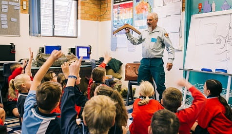 Uncle Mark leading an incursion at Coffs Harbour Christian Community School, 2019. Jay Black © NPWS