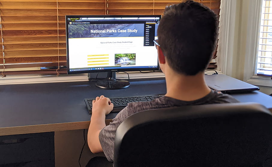 A student interacts with NPWS online learning resources. Photo: Erin Rowe © DPIE
