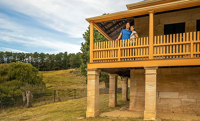 A couple on the balcony at St Bernard's Presbytery, Hartley Historic Site. Photo: John Spencer/OEH.