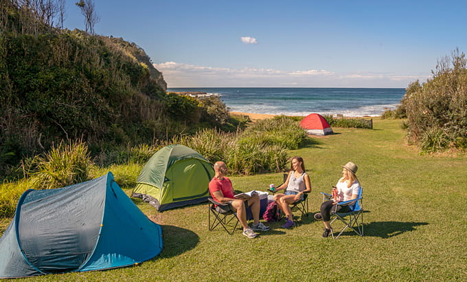 People relaxing at Little Beach campground, Bouddi National Park. Photo: John Spencer/DPIE